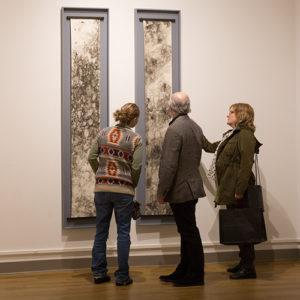 Examining artwork