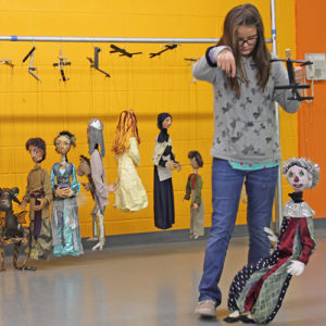 Girl practicing with marionette